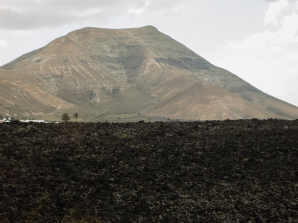 Caldera, volcanic mountain, and black lava at Parque Nacional de Timanfaya (Timanfaya National Park) -- they could have filmed part of Star Wars here!; Lanzarote, Canary Islands