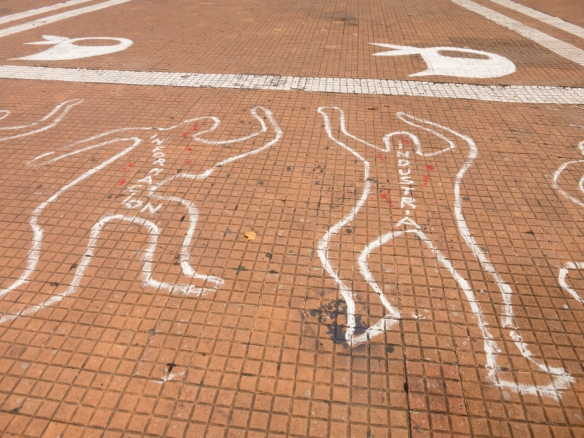 Chalk figures at Plaza de Mayo memorializing the 26 people killed in the December 2001 anti-government uprising, Buenos Aires, Argentina
