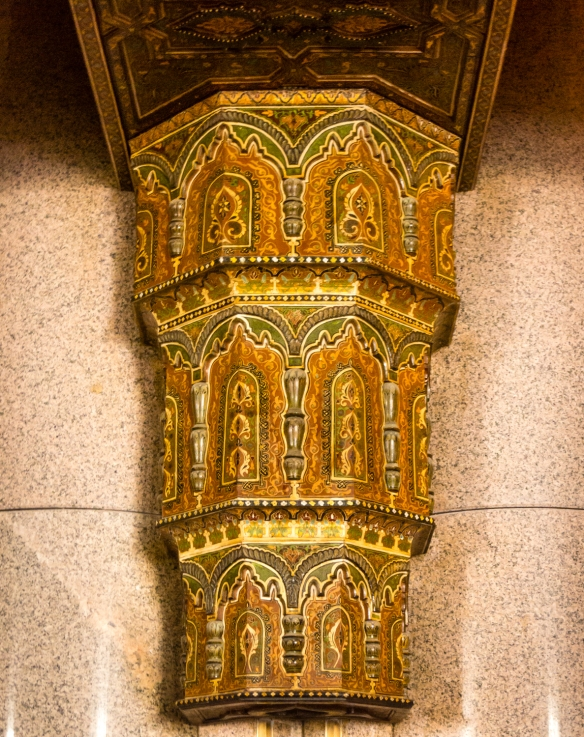 Elaborately carved and painted wooden column support for ceiling beams on the side entrance to the Prayer Hall inside La Mosquée Hassan II (Hassan II Mosque), Casablanca, Morocco