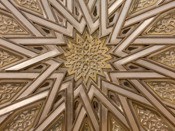 Geometric design on a bronze door at the ceremonial entrance to Palais Royal (Royal Palace), Casablanca, Morocco