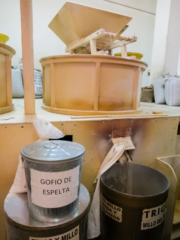 Grinding the cooled, roasted grains into flour (gofio) at Molino de Gofio (the Gofio Mill)  in the town of El Sauzal, Tenerife, Canary Islands