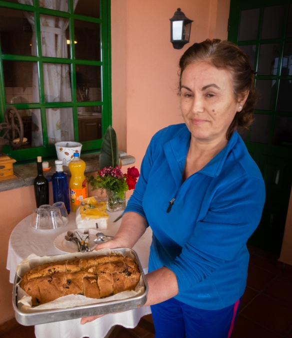 "Mama serving her freshly baked raisin-nutmeg bread at our ""Mama's"" Canarian luncheon at her private home in El Sauzal, Tenerife, Canary Islands"