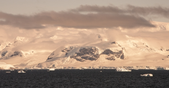 Mountains and glaciers with evening light as we sailed towards Drake Passage and Argentina from Port Lockroy, Antarctica