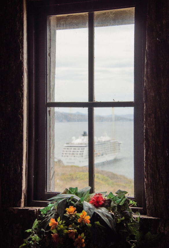Our ship framed by the window in the old wooden church, Cabo de Hornos (Cape Horn), Chile