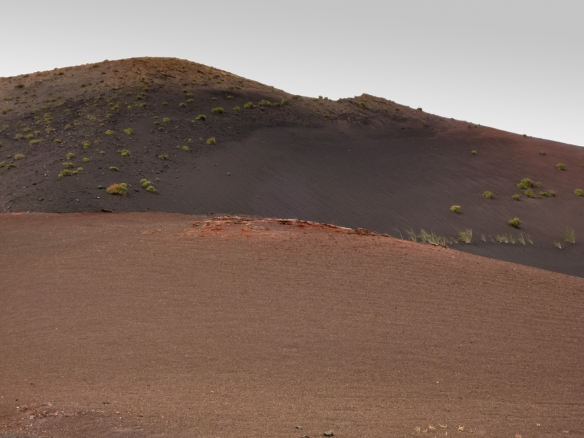 Red lava rock:ash indicates the presence of iron in the volcanic landscape of Parque Nacional de Timanfaya (Timanfaya National Park), Lanzarote, Canary Islands