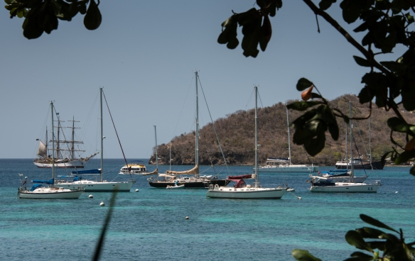 Relaxing on the dining deck at Mac's Pizzeria overlooking the bay and the sailboats at anchor, Bequia, Grenadines, Caribbean Sea