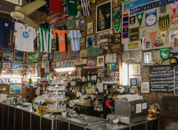 The bar, festooned with memorabilia from the celebreties who have eaten there, El Obrero, in La Boca, Buenos Aires, Argentina