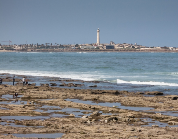 The Casablanca lighthouse, viewed from La Mosquée Hassan II (Hassan II Mosque), Casablanca, Morocco