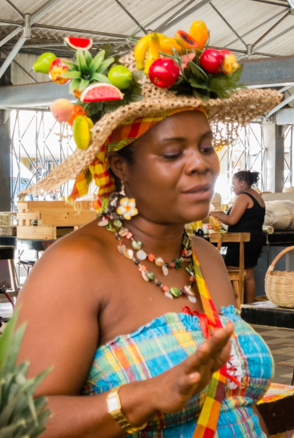 The hat gives away what this lady is selling at the city's central market, Fort-de-France, Martinique, Caribbean Sea