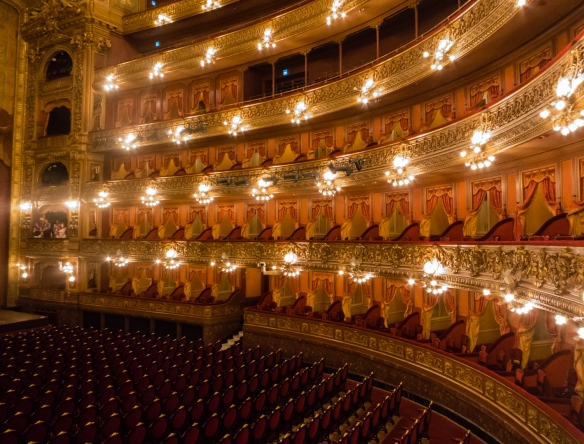 The horseshoe shaped main hall with a 65 foot (20 m) wide stage at Teatro Colón (Columbus Theatre, the main opera house), Buenos Aires, Argentina