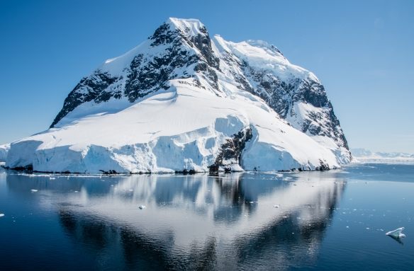 The Lemaire Channel (on the right side) passes closely by Booth Island with its sheer mountains, Antarctica