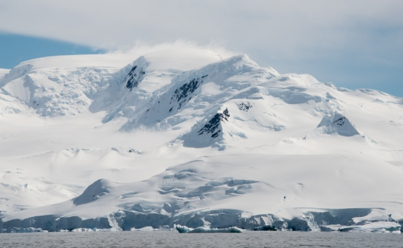 The mountainous coast with glaciers of the Dallmann Fjords near Northern Anvers Island, Antarctica