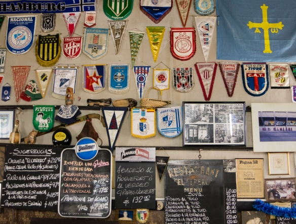 The restaurant walls are covered in soccer memorabilia, El Obrero, in La Boca, Buenos Aires, Argentina