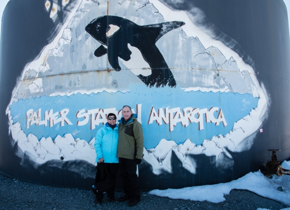 Your intrepid exploer and blogger in front of a giant oil storage tank at the U.S. Antarctic Program's Palmer Station in Arthur Harbour on Avers Island, Antarctica