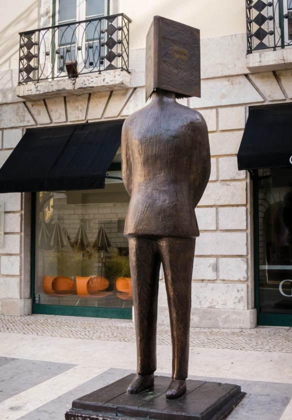 Monument to (statue of) Fernando Pessoa, a Portuguese poet, writer, literary critic, translator, publisher & philosopher, described as one of the greatest poets in the Portuguese language, Chiado District, Lisbon, Portugal