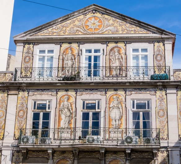 "The artwork of this facade is actually painted on individual Portuguese ceramic tiles that were installed as a ""mosaic"", Chiado District, Lisbon, Portugal"