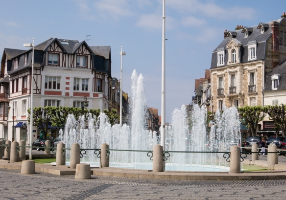 A fountain in a traffic circle in the heart of Deauville, Normandy region, France