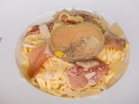 A plat (main course) of fettucine with proscuito and foie gras, at Villa Gabrielle, Deauville, Normandy region, France--