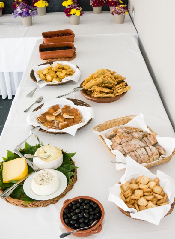 A selection of appetizers (baked chorizo, blood sausage, empanadas, cod fritters, chorizo sandwiches, cheese, bread, and olives) at Quinta da Pacheca, Lamego, Douro Valley, Portugal