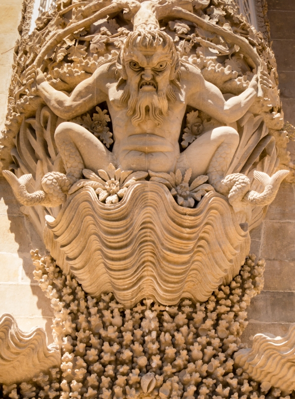 A sinister gargoyle guards one of the upper level entrances to the Palácio Velho (Old Palace) at Palácio Nacional da Pena (Pena Palace), Sintra (near Lisboa-Lisbon), Portugal