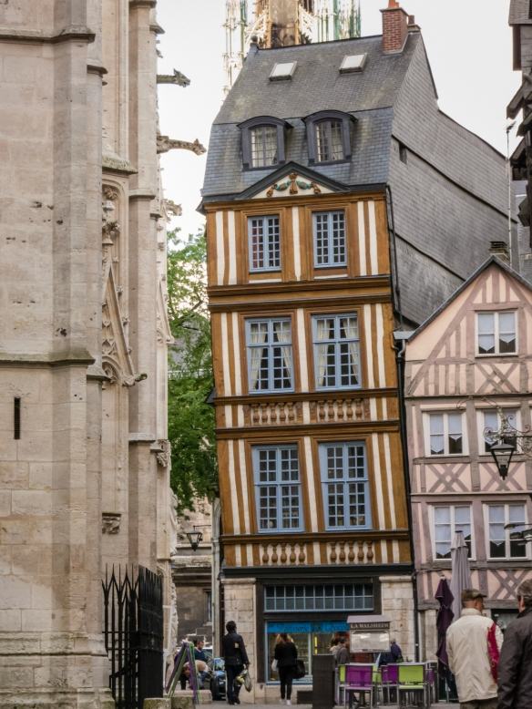 Across the street from the magnificent Gothic Rouen Cathedral, a old half-timbered Norman-style house leans like the Leaning Tower of Pisa, Rouen, Normandy region, France