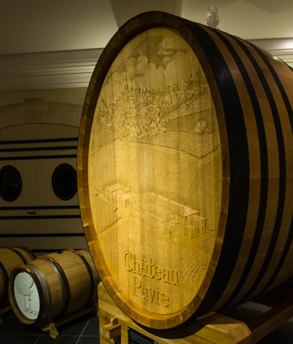 An elaborately carved oak barrique used for blending in the barrel cellars of Château Pavie, Saint-Émilion, Bordeaux region, France