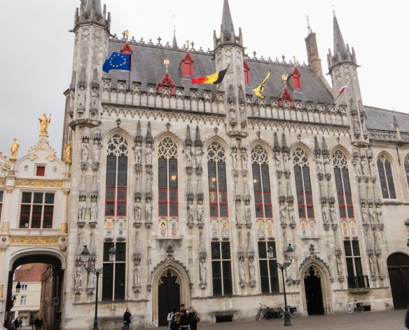 Bruges Stadhuis (Town Hall), constructed between 1376 and 1420 in the Gothic style on the Burg Square, with statues (now reproductions) of the counts of Flanders filling 49 niches, Bruges, Belgium