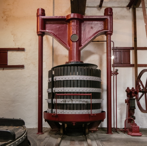 "Closeup of a wine press from the 19th century in the ""wine making museum"" of old equipment from the estate, Château Lynch-Bages, Pauillac, Gironde, France--"
