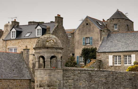 Closeup of houses and a turret in Roscoff, Brittany, France