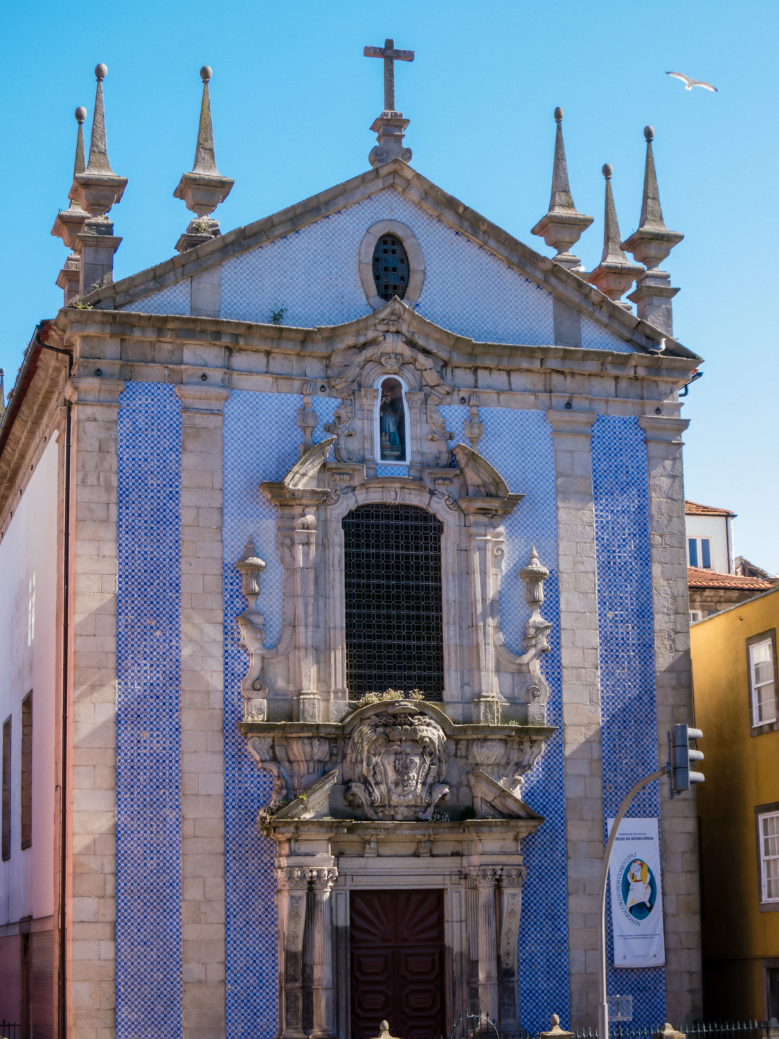 Igreja De São Nicolau (Church Of St. Nicholas) With The Facade Covered In