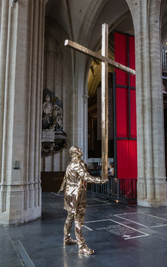 "Jan Fabre's sculpture ""The Man Who Bears the Cross"", Cathedral of Our Lady, Antwerp, Belgium"