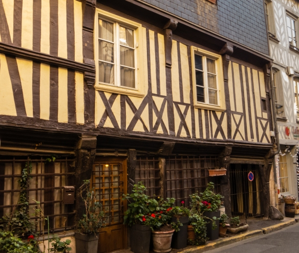 Many of the city's oldest buildings for homes and businesses are built in the Normandy half-timbered style, Honfleur, Normandy region, France