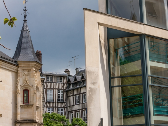 On the edge of old town, an interesting contrast of three architectural styles – French Gothic, Normandy half-timbered and 21st century modern; Rouen, Normandy region, France