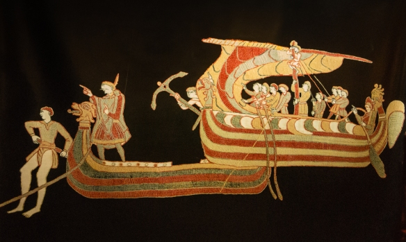 Photograph of a photographic enlargement of a segment of the Bayeux Tapestry depicting sailors on boats searching for their landing spot, Bayeux, Normandy region, France