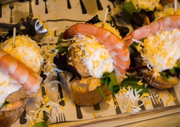Seafood mousse topped with mayonnaise and cheese and a prawn tapas (locally called pinchos) at Casa Lita in Santander, Spain