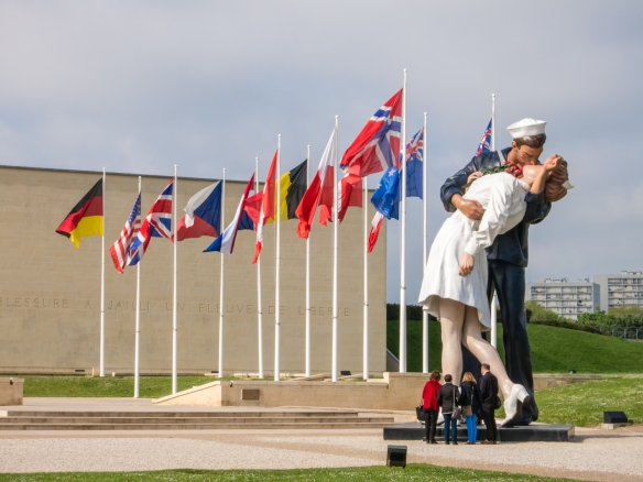 "Seward Johnson's sculpture ""Unconditional Surrender"" was inspired by the famous photograph taken by Alfred Eisenstaedt in Times Square, NY, on 14 August 1945, signaling the end of WW II; Caen Memorial, Normandy, France"
