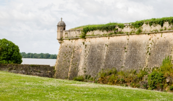 Stone gatehouse bastion Father, surmounted by a fleur de lys, emblem of the French monarchy, Blaye Citadel, Blaye, Bordeaux region, France