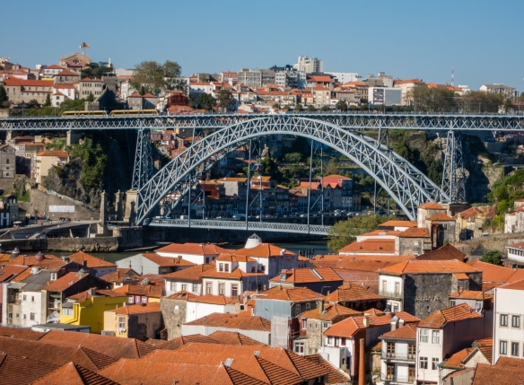 Taylor's lodges (warehouses for aging port) and tasting room overlook Ponte Dom Luis I (Dom Luis I Bridge) which spans the Douro River, connecting Porto (top side in photograph) with Vila Nova de Gaia; Porto (Oporto), Portugal