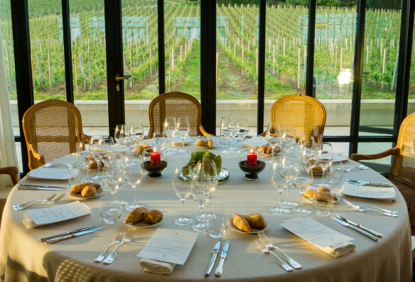 Terrific views of the surrounding vineyards from the dinner table in the reception hall at Château Pavie, Saint-Émilion, Bordeaux region, France