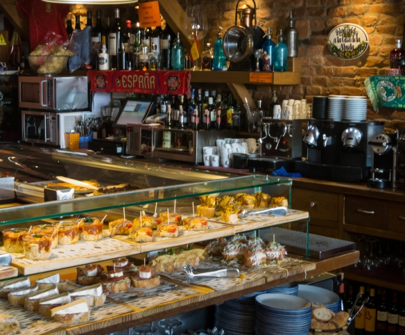 The bar and one of three counters displaying tapas (locally called pinchos) for selection at Casa Lita in Santander, Spain