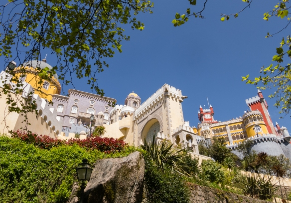 The beautiful Palácio Nacional da Pena (Pena Palace) is the standout monument of Sintra with an exterior painted in vivid colours, decorative towers and battlements and statues of mythological creatures, (near Lisboa-Lisbon), Portugal