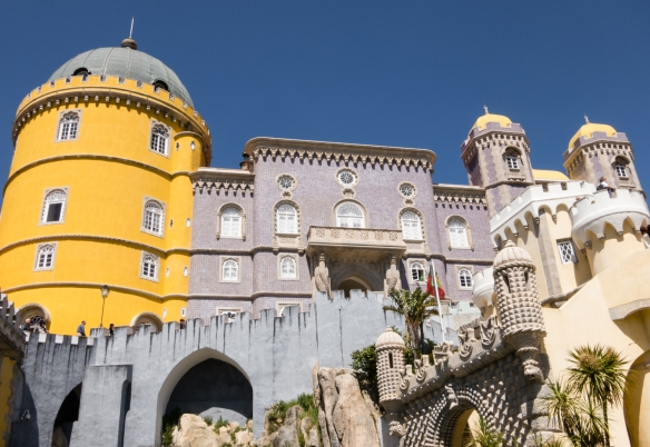 The beautiful Pena Palace is the standout monument of Sintra with an exterior painted in vivid colours, with decorative towers and battlements and statues of mythological creatures, Sintra (near Lisboa-Lisbon), Portugal