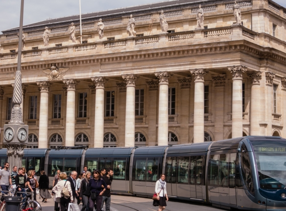 The city built an ultra-modern urban train system, shown here in contrast with the classical Grand Théâtre, Bordeaux, France