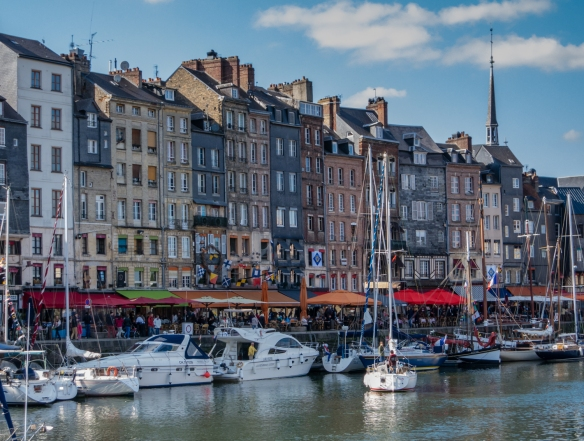 The colorful, narrow houses along the Vieux Bassin (old basin, or old harbor), in Honfleur, Normandy region, France, have been immortalized by such Impressionist painters as Claude Monet and Gustave Coubet