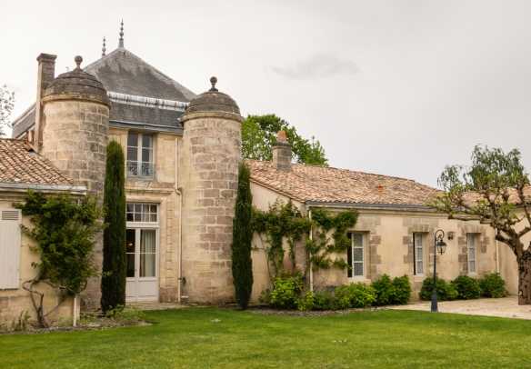 The interior courtyard of Château Cordeillan-Bages with two round turrets built several hundred years ago, Pauillac, France