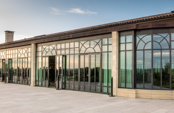 The reception hall and terrace are on the upper level of the winery building at Château Pavie, Saint-Émilion, Bordeaux region, France