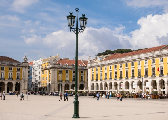 The symmetrical buildings of Praça do Comércio (Commerce Square) were filled with government bureaus that regulated customs and port activities, Lisbon, Portugal