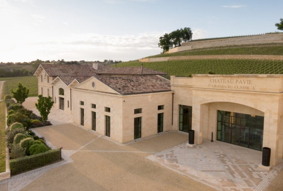The winery, offices and reception facilities of Château Pavie, Saint-Émilion, Bordeaux region, France, are in beautiful new buildings constructed of limestone blocks, on the slopes amidst the vineyards