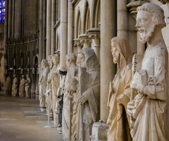 This row of apostles are the surviving statues from the front façade's tympanum -- seen close up in the ambulatory of the church, Rouen Cathedral, Rouen, Normandy region, France