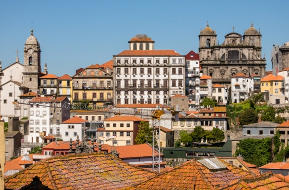 Tiled roofs and distant churches viewed from the plaza of Catedral Se do Porto, Porto (Oporto), Portugal